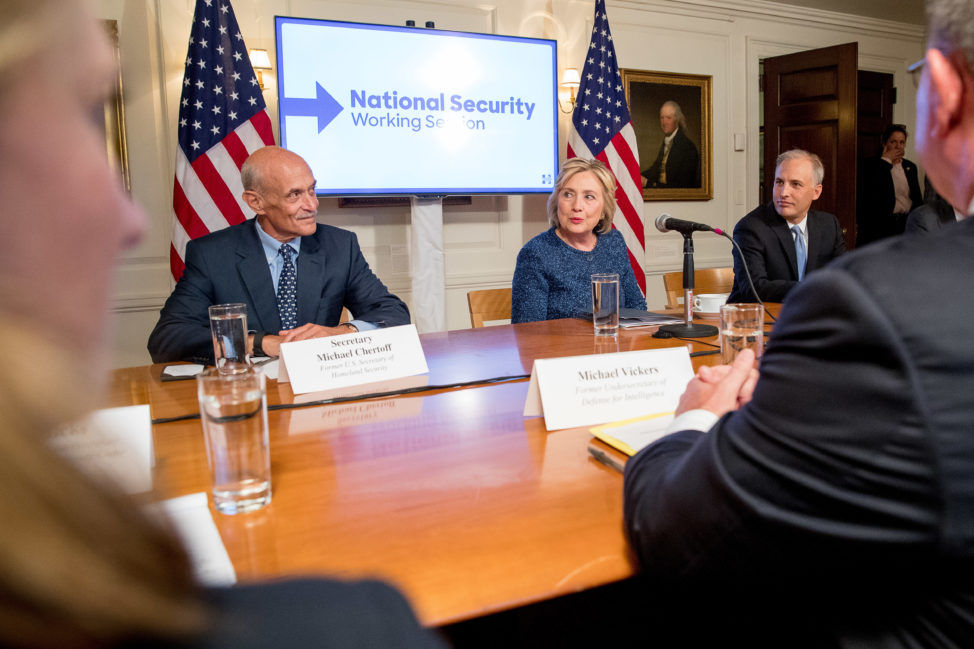 Democratic presidential candidate Hillary Clinton, center, accompanied by former National Counterterrorism Center Director Matt Olson, right, and former Homeland Security Secretary Michael Chertoff, left, attends a National Security working session at the Historical Society Library in New York, Sept. 9, 2016. (AP)