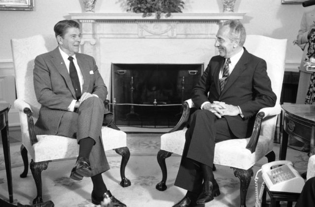 U.S. President Ronald Reagan talks with Prime Minister of Israel Shimon Peres, right, during a meeting at the White House, Tuesday, Oct. 9, 1984. Peres was in Washington for a round of meetings with top administration officials seeking more U.S. aid for Israel's inflation-ravaged economy. (AP)