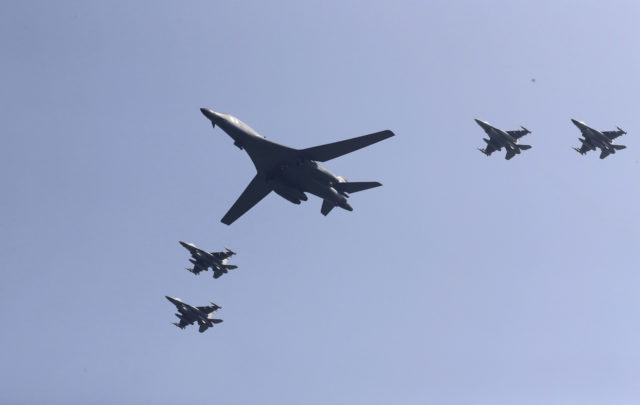 U.S. B-1 bomber, center, flies over Osan Air Base with U.S. jets in Pyeongtaek, South Korea, Tuesday, Sept. 13, 2016. The United States has flown nuclear-capable supersonic bombers over ally South Korea in a show of force meant to cow North Korea after its fifth nuclear test and also to settle rattled nerves in the South. (AP)