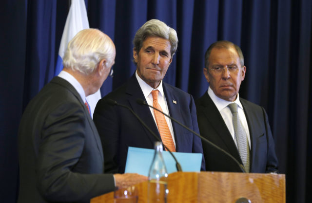 U.S. Secretary of State John Kerry, center, and Russian Foreign Minister Sergei Lavrov, right, look at U.N. special envoy Staffan de Mistura during a joint press conference following their meeting to discuss the crisis in Syria, in Geneva, Switzerland, Sept. 9, 2016. (AP)