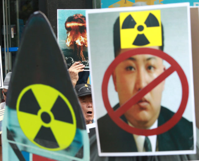 "A South Korean protester shouts slogans during a rally denouncing North Korea's latest nuclear test in Seoul, South Korea, Saturday, Sept. 10, 2016. The U.N. Security Council is strongly condemning North Korea's latest nuclear test and says it will start discussions on ""significant measures"" against Pyongyang including new sanctions. (AP)"