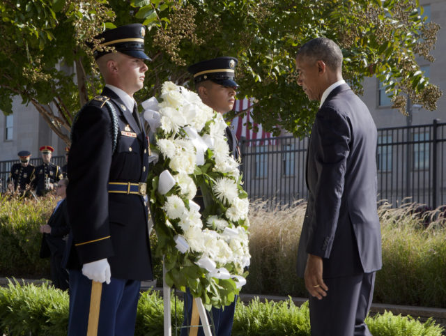 President Barack Obama pauses as he lays a wreath during a memorial observance ceremony at the Pentagon, Sunday, Sept. 11, 2016, to commemorate the 15th anniversary of the 9/11 terrorist attacks. (AP)