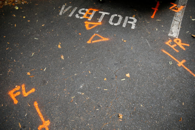 Orange spray paint used by police investigators is seen at a parking spot at The Village at College Downs apartment complex the morning after the police shooting of Keith Scott, in Charlotte, North Carolina, Sept. 21, 2016. (Reuters)