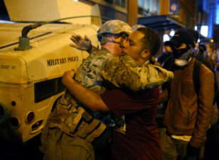 A U.S. National guard soldier accepts a hug from protester as people march through downtown to protest the police shooting of Keith Scott in Charlotte, North Carolina, Sept. 22, 2016. (Reuters)
