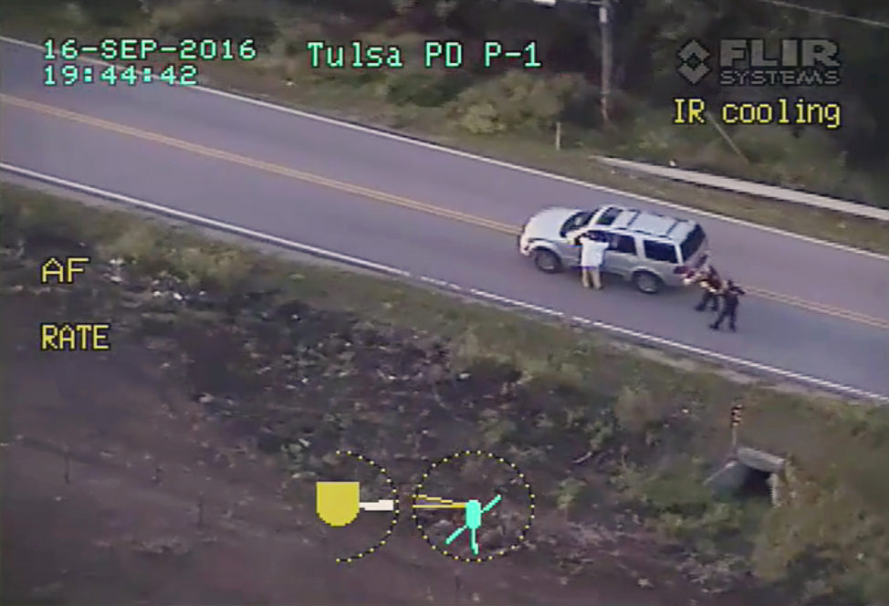 In this photo made from a Sept. 16, 2016 police video, Terence Crutcher, left, with his arms up is pursued by police officers as he walks next to his stalled SUV moments before he was shot and killed by one of the officers in Tulsa, Okla. Officer Betty Shelby was charged with felony manslaughter for firing the shots that killed Crutcher. She was released after posting $50,000 bond. (AP)