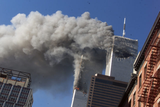 FILE - In this Sept. 11, 2001 file photo, smoke rising from the burning twin towers of the World Trade Center after hijacked planes crashed into the towers, in New York City. Every American of a certain age has a 9/11 story _ vivid memories of where they were, what they saw, how they felt on that awful day. (AP)