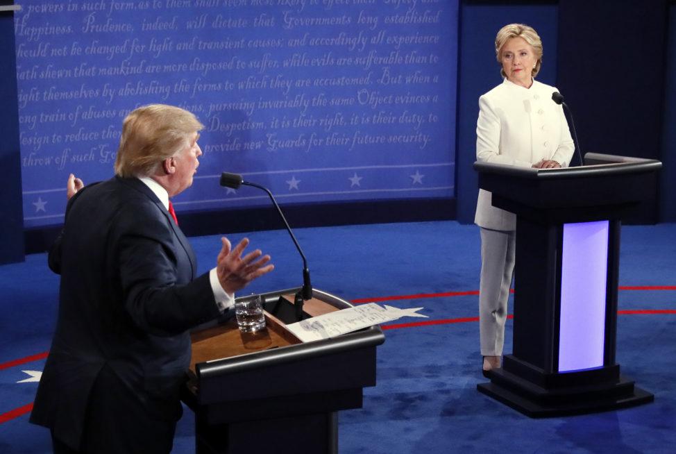 Democratic presidential nominee Hillary Clinton and Republican presidential nominee Donald Trump debate during the third presidential debate at UNLV in Las Vegas, Oct. 19, 2016. (AP)