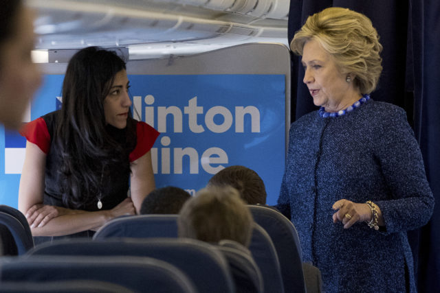 In this Oct. 28, 2016 file photo, Democratic presidential candidate Hillary Clinton speaks with senior aide Huma Abedin aboard her campaign plane at Westchester County Airport in White Plains. The longtime Hillary Clinton aide at the center of a renewed FBI email investigation testified under oath four months ago she never deleted old emails, despite promising in 2013 not to take sensitive files when she left the State Department. (AP)