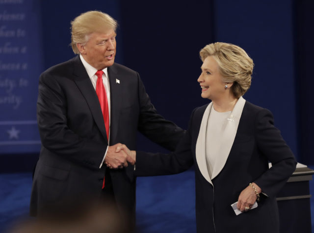 Republican presidential nominee Donald Trump shakes hands with Democratic presidential nominee Hillary Clinton following the second presidential debate at Washington University in St. Louis, Oct. 9, 2016. (AP)