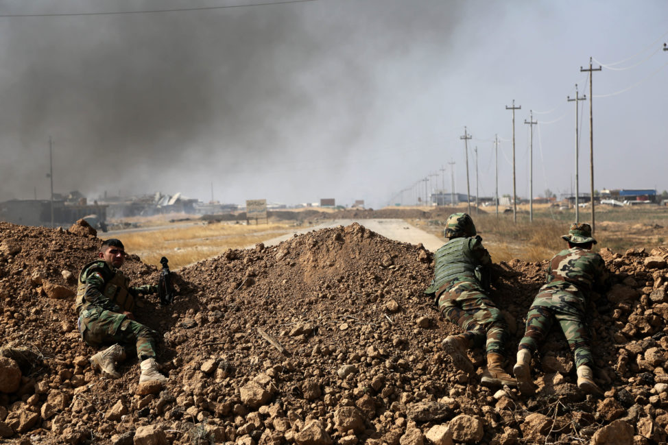 Kurdish security forces take up a position as they fight overlooking the Islamic State-controlled in villages surrounding Mosul, in Khazer, about 30 kilometers (19 miles) east of Mosul, Iraq, Oct. 17, 2016. Iraqi government and Kurdish forces, backed by U.S.-led coalition air and ground support, launched coordinated military operations early on Monday as the long-awaited fight to wrest the northern city of Mosul from Islamic State fighters got underway. (AP)