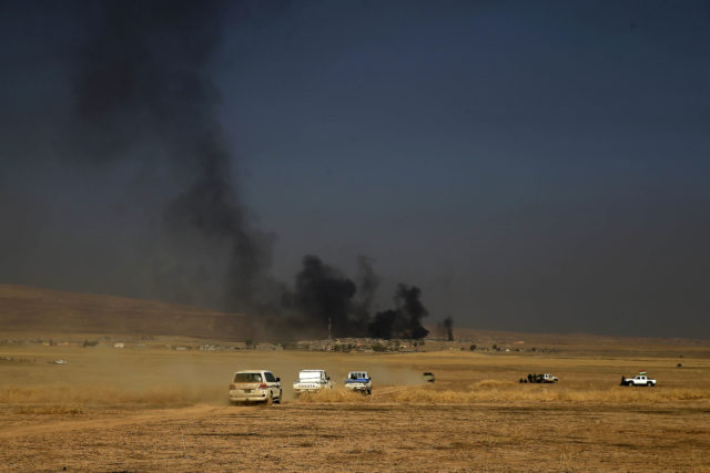 A peshmerga convoy drives towards a frontline in Khazer, about 30 kilometers (19 miles) east of Mosul, Iraq, Oct. 17, 2016. The Iraqi military and the country's Kurdish forces say they launched operations to the south and east of militant-held Mosul early Monday morning. (AP)