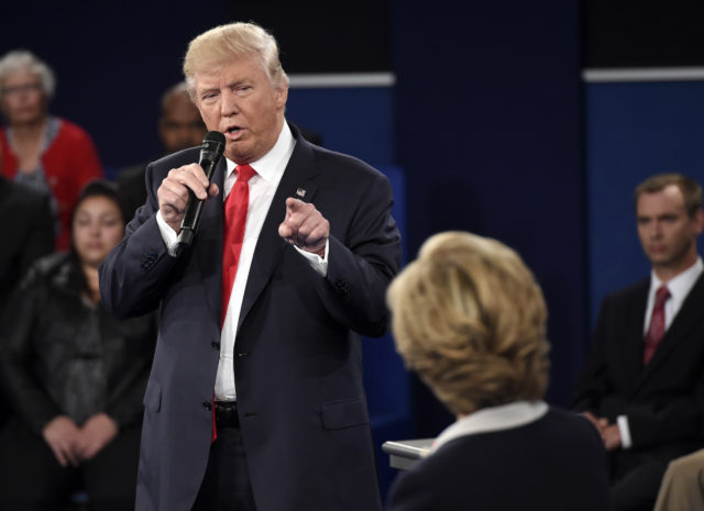 Republican presidential nominee Donald Trump points at Democratic presidential nominee Hillary Clinton as he speaks during the second presidential debate at Washington University in St. Louis, Oct. 9, 2016. (AP)