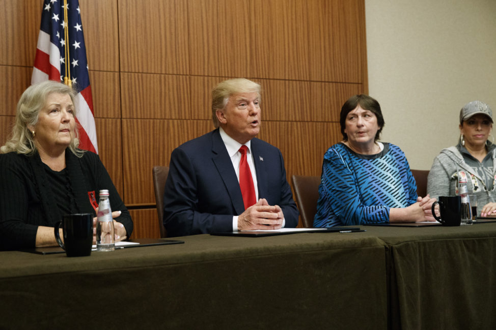 Republican presidential candidate Donald Trump makes remarks before the second presidential debate with two women who have accused former president Bill Clinton of sexual assault. From right, Paula Jones, Kathy Shelton, Trump, and Juanita Broaddrick. Shelton alleged she was raped at age 12 by a 41-year old man who Hillary Clinton was assigned to defend. Oct. 9, 2016, in St. Louis.