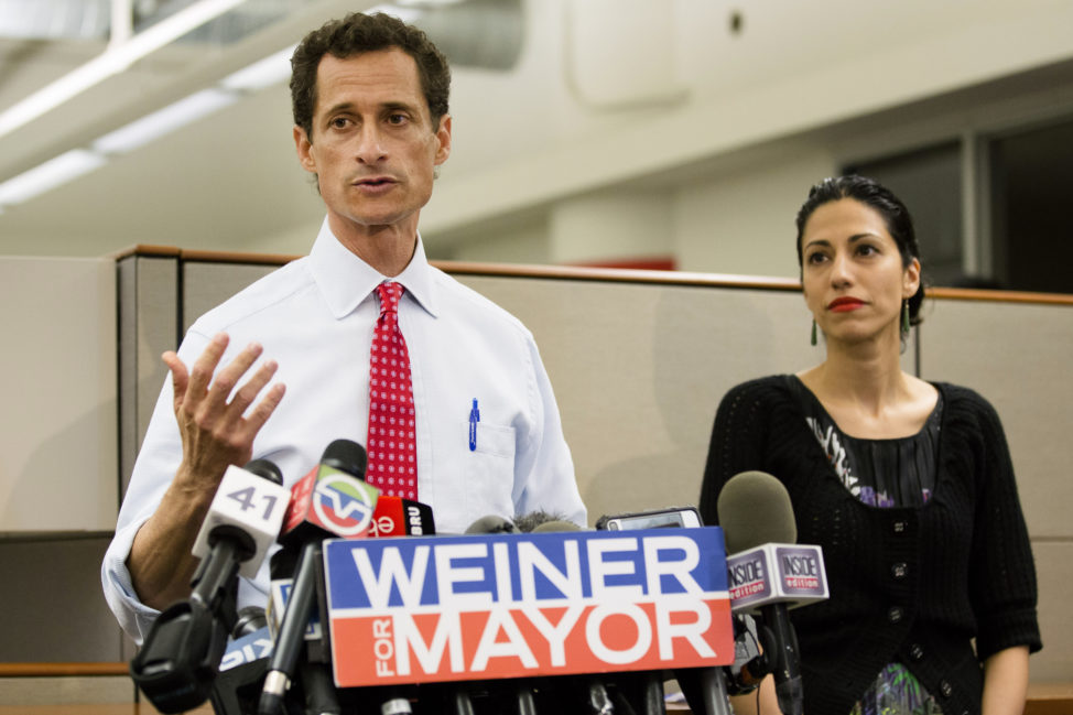 In this July 23, 2013 file photo, then-New York mayoral candidate Anthony Weiner speaks during a news conference alongside his wife Huma Abedin in New York. The FBI informed Congress on Friday, Oct. 28, 2016, it is investigating whether there is classified information in new emails that have emerged in its probe of Hillary Clinton's private server. The newly discovered emails emerged through the FBI's separate sexting probe of Weiner, the now estranged husband of Abedin, a close confidant of Clinton. (AP)