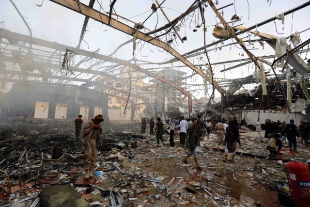 People inspect the aftermath of a Saudi-led coalition airstrike in Sanaa, Yemen, Saturday, Oct. 8, 2016. Yemeni Health Ministry and medical groups say at least 100 people were killed in a Saudi-led coalition airstrike that targeted a funeral hall in the capital, Sanaa.  (AP)