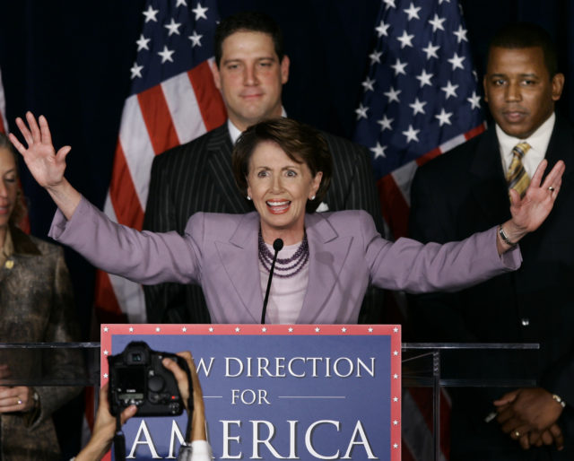 In this photo from Nov. 7, 2006, House Democratic Leader Rep. Nancy Pelosi, D-Calif., fires up fellow Democrats at an election night rally in Washington. Standing behind her is Rep. Tim Ryan, D-Ohio, who is now seeking to replace Pelosi as House Democratic Leader. (AP)