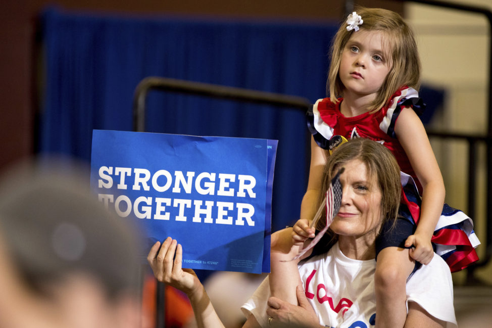 A girl and a woman's shoulders as Democratic presidential candidate Hillary Clinton speaks at a rally at Abraham Lincoln High School, in Des Moines, Iowa, Aug. 10, 2016. (AP)