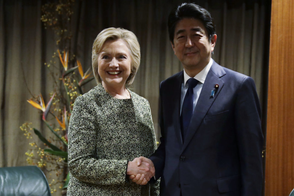 Democratic presidential candidate Hillary Clinton poses for photographs with Japanese Prime Minister Shinzo Abe in New York, Sept. 19, 2016. Clinton requested the meeting, which happened on the sidelines of the U.N. General Assembly. Japanese officials said at the time that Trump did not request a meeting with Abe. (AP)