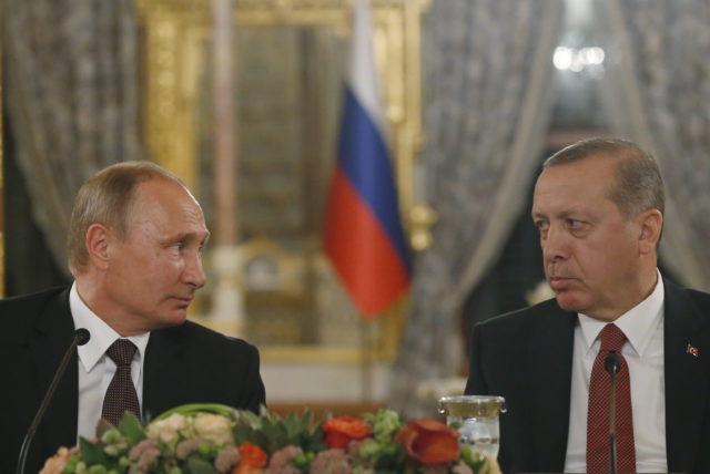 Turkey's President Recep Tayyip Erdogan, right and Russian President Vladimir Putin, left, look at each other during a news conference following their meeting in Istanbul Oct. 10, 2016. Putin and Erdogan voiced support for the construction of a gas pipeline from Russia to Turkey, called Turkish Stream, a project that was suspended amid tensions between the two countries. The pipeline would carry Russian natural gas to Turkey and onto European Union countries. (AP)