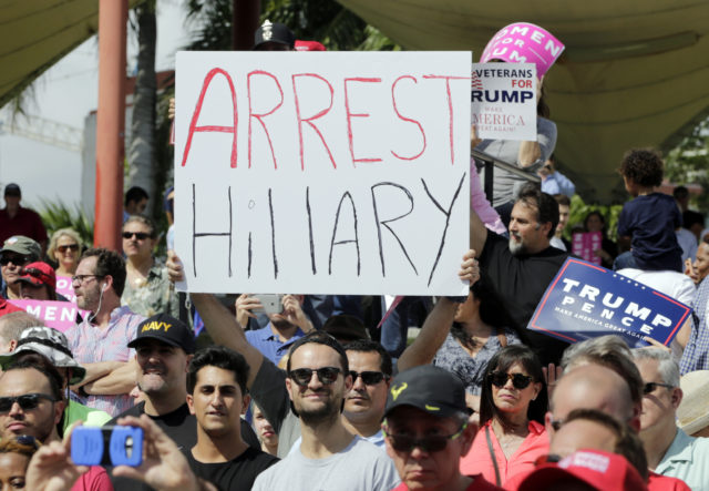 A supporter of Republican presidential candidate Donald Trump holds up a sign referring to Democratic presidential candidate Hillary Clinton during a Trump campaign rally at Bayfront Park Amphitheater, Nov. 2, 2016, in Miami. (AP)