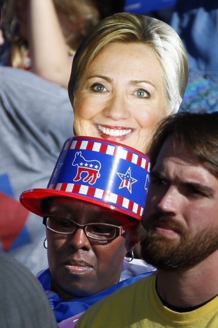 A supporter of Democratic presidential candidate Hillary Clinton listens as she speaks at a rally in front of the Cathedral of Learning on the University of Pittsburgh campus in Pittsburgh, Nov. 7, 2016. (AP)