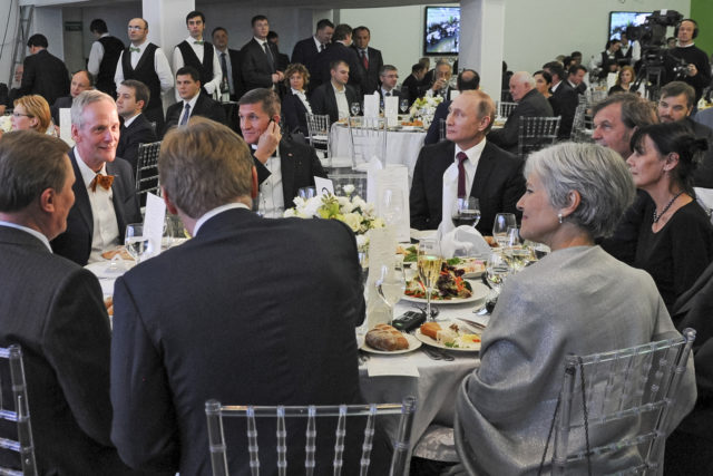 In this file photo taken on Dec. 10, 2015, Russian President Vladimir Putin, center right, with retired U.S. Lt. Gen. Michael T. Flynn, center left, and Serbian filmmaker Emir Kusturica, obscured second right, attend an exhibition marking the 10th anniversary of RT (Russia Today) 24-hour English-language TV news channel in Moscow, Russia. Flynn is president-elect Donald Trump's choice to be national security adviser. (AP)