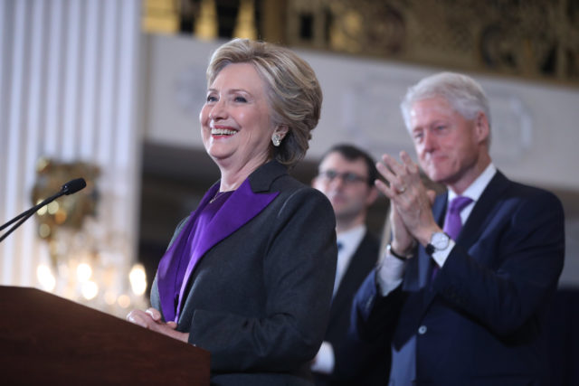 Former President Bill Clinton applauds as his wife, Democratic presidential candidate Hillary Clinton speaks in New York, Nov. 9, 2016. Clinton conceded the presidency to Donald Trump in a phone call early Wednesday morning, a stunning end to a campaign that appeared poised right up until Election Day to make her the first woman elected U.S. president. (AP)