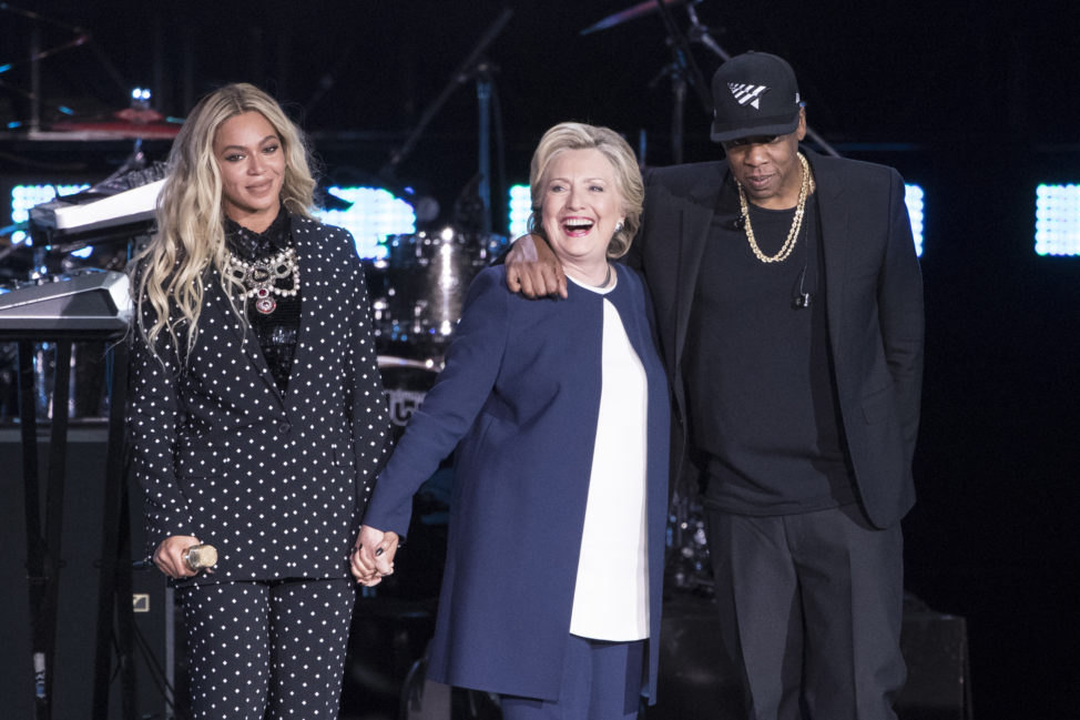 Jay Z, right, and Beyonce, left, stand with Democratic presidential candidate Hillary Clinton during a campaign rally in Cleveland, Nov. 4, 2016. (AP)