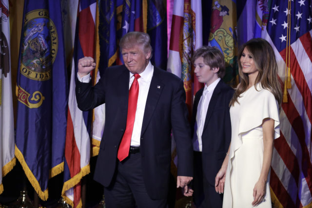 President-elect Donald Trump pumps his fist after giving his acceptance speech as his wife Melania Trump, right, and their son Barron Trump follow him during his election night rally, Nov. 9, 2016, in New York. (AP)