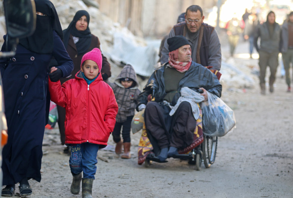People walk as they gather to be evacuated from a rebel-held sector of eastern Aleppo, Syria December 15, 2016. (Reuters)