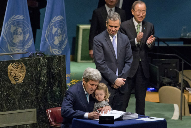 U.S. Secretary of State John Kerry holds his granddaughter as he signs the Paris Agreement on climate change, April 22, 2016 at U.N. headquarters. (AP)