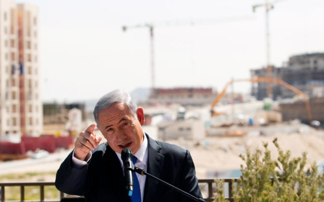 Israeli Prime Minister Benjamin Netanyahu delivers a statement in March 2015, in front of a new construction, in the Jewish settlement known to Israelis as Har Homa and to Palestinians as Jabal Abu Ghneim, in an area of the West Bank that Israel captured in a 1967 war and annexed to the city of Jerusalem. (Reuters)
