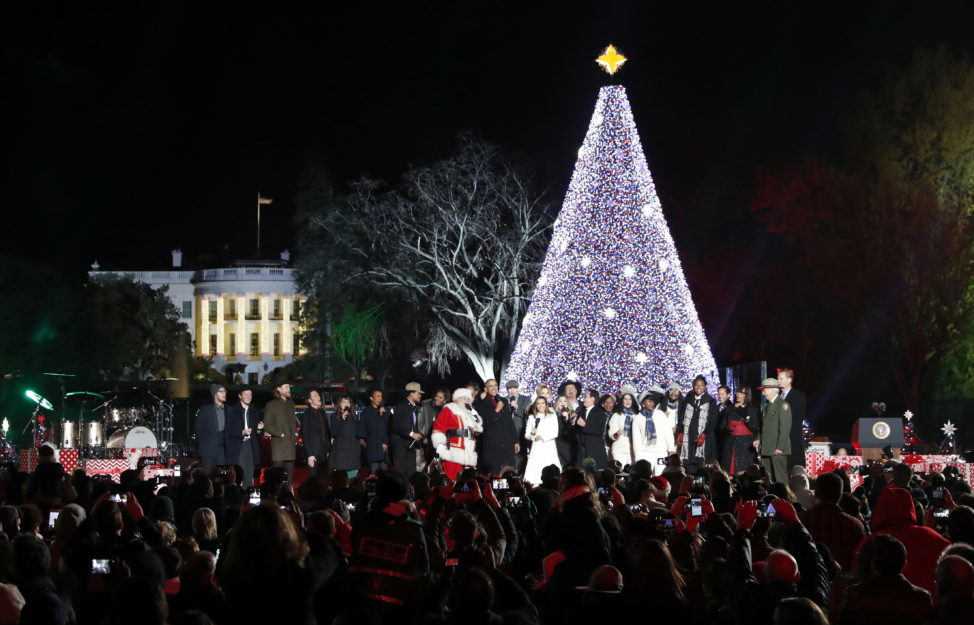 President Barack Obama, with Michelle Obama, and daughter Sasha, sing with Santa Claus and others during the lighting ceremony for the 2016 National Christmas Tree is seen before the lighting ceremony on the Ellipse near the White House, Dec. 1, 2016 in Washington. (AP)