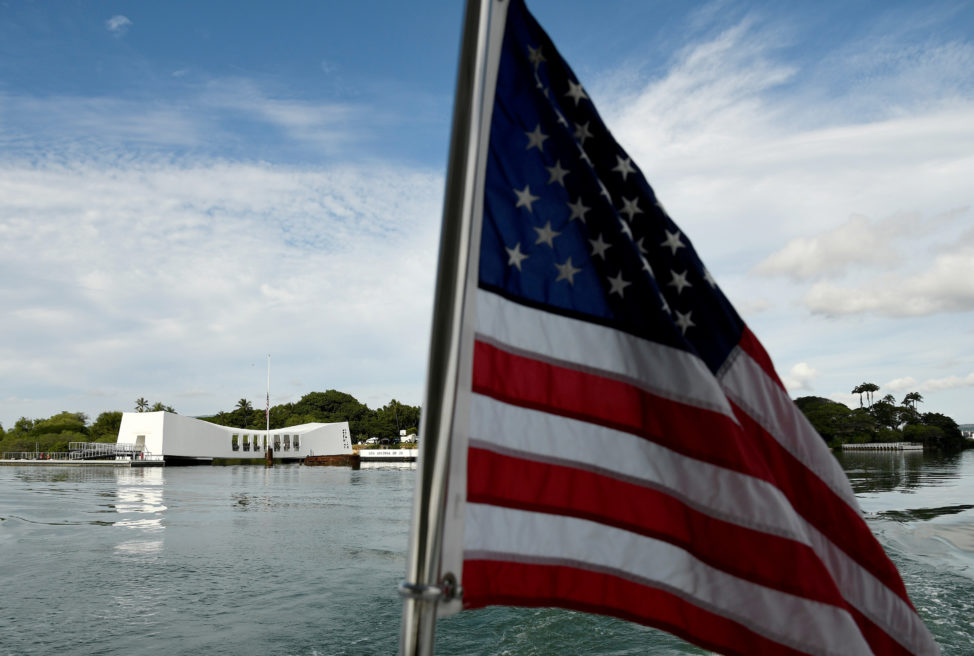 The USS Arizona Memorial can be seen from a shuttle boat during the 75th anniversary of the attack on Pearl Harbor in Honolulu, Hawaii December 7, 2016. (Reuters)