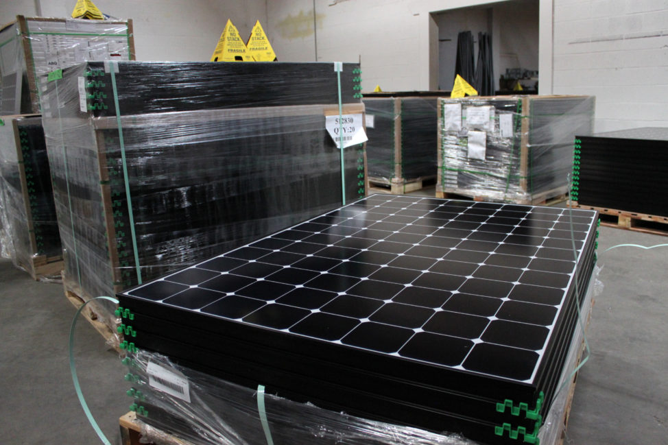 In this March 9, 2016 file photo, the latest generation of SunPower solar panels are stacked in Positive Energy Solar's warehouse in Albuquerque, N.M. (AP)