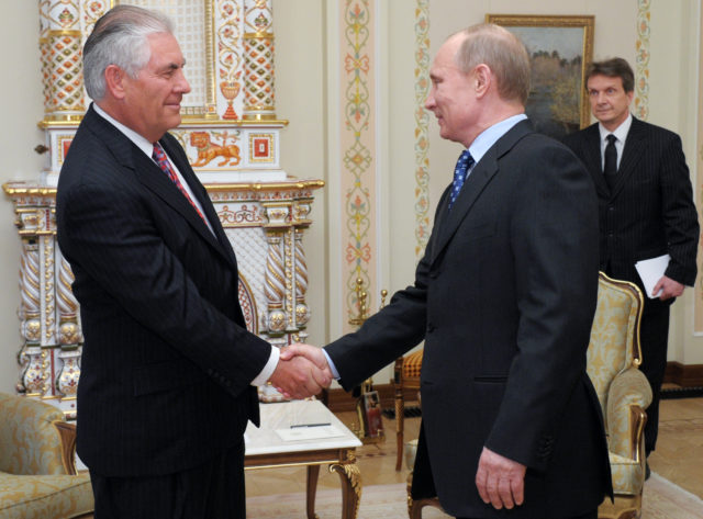 Russian Prime Minister Vladimir Putin, right, shakes hands with Rex W. Tillerson, chairman and CEO of Exxon Mobil Corporation at their meeting in the Novo-Ogaryovo residence outside Moscow, April 16, 2012. Exxon is teaming up with Russian oil giant Rosneft to develop oil and natural gas fields in Russia and North America. The companies signed an agreement that was first announced in August. (AP)