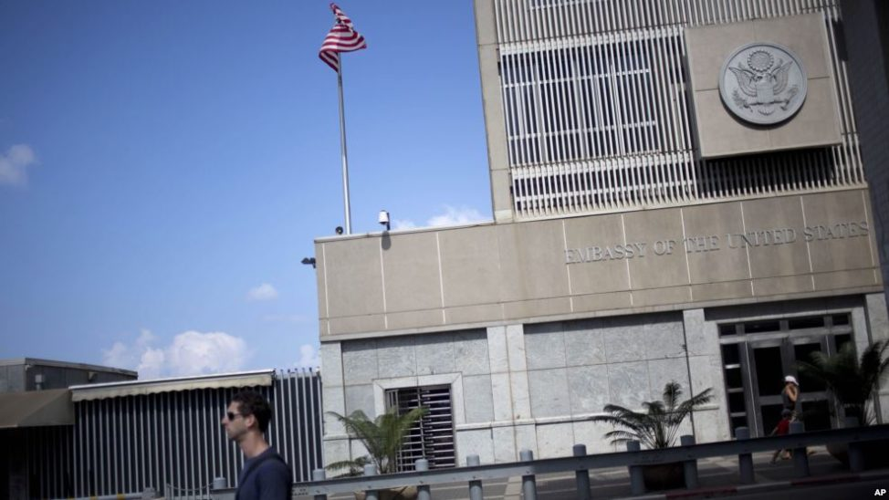 A,man walks past the U.S Embassy in Tel Aviv, Israel in this file photo from Aug. 4, 2013. President-elect Trump's choice to be the U.S. ambassador to Israel has said he intends to work out of a U.S. embassy in Jerusalem. Long-time U.S. policy is to keep the embassy in Tel Aviv until a agreement is reached between the Israelis and Palestinians over Jerusalem's status. (AP)