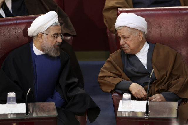In this March 2014 photo, Iranian President Hassan Rouhani, left, and former President Akbar Hashemi Rafsanjani, who are members of the Assembly of Experts, confer in a biannual meeting of the assembly in Tehran, Iran. Rafsanjani died January 8 of a heart attack in Tehran. He was 82.