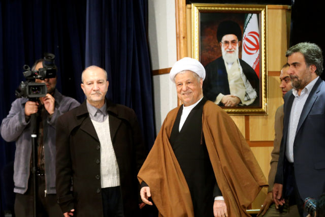 In this December 2015 photo, former Iranian President Akbar Hashemi Rafsanjani, center, who is also a member of the Experts Assembly, arrives for a press briefing after registering his candidacy for the Feb. 26 elections of the assembly at interior ministry in Tehran, Iran. Rafsanjani died of a heart attack January 8 in Tehran. He was 82. (AP