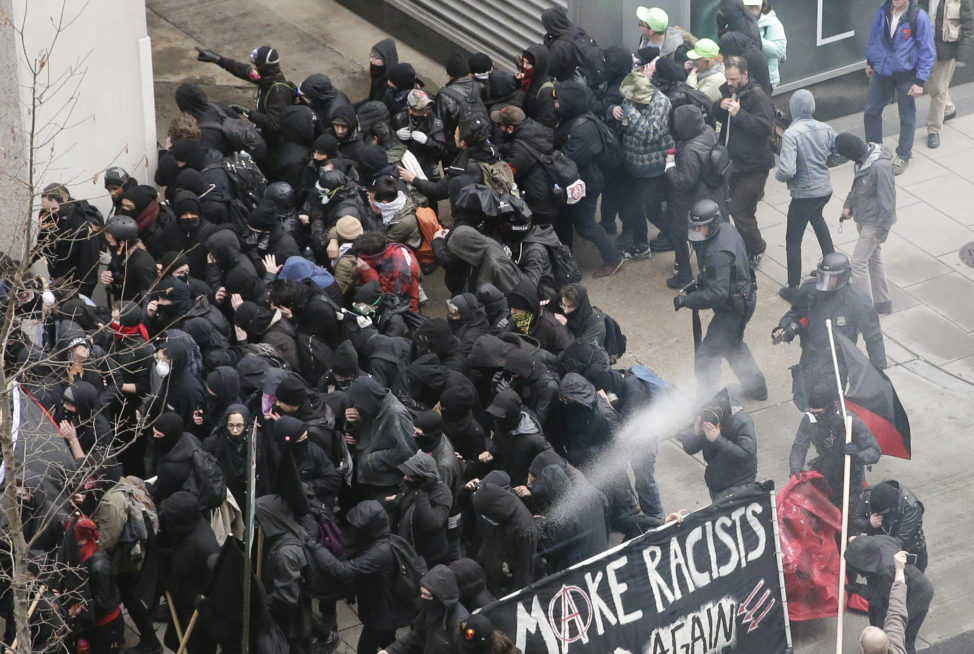 Police use pepper spray on protesters in Washington, Friday, Jan. 20, 2017, in a chaotic confrontation blocks from Donald Trump's inauguration as protesters registered their rage against the new president. (AP)
