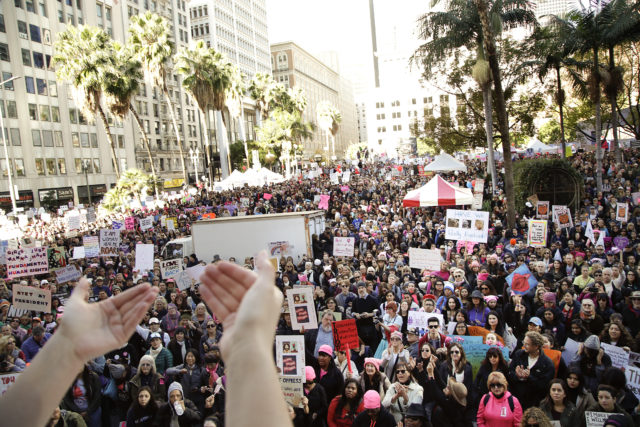 Protesters listen to a speaker as they gather for the Women's March against President Donald Trump, Jan. 21, 2017, in Los Angeles. The march is being held in solidarity with similar events taking place in Washington and around the nation. (AP)