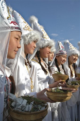 "Kyrgy girls wearing national costumes take part in festivities marking the holiday of Navruz in Bishkek, Kyrgyzstan, Tuesday, March  21, 2006. Navruz, Central Asia's spring ""New Year"" holiday, falls on March 21. (AP Photo/AKIpress, Azamat Imanaliev)"