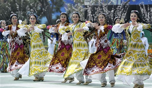 "Folk dancers in national costumes perform during the festivities marking the holiday of Navruz in Tashkent, Uzbekistan, Tuesday, March 23, 2010. Navruz, central Asia's spring ""New Year"" holiday, falls on March 21. (AP Photo/Anvar Ilyasov)"